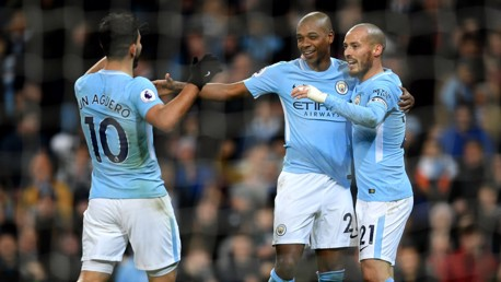 ​MIDFIELD MAESTRO: City celebrate Fernandinho's cooly-taken finish.