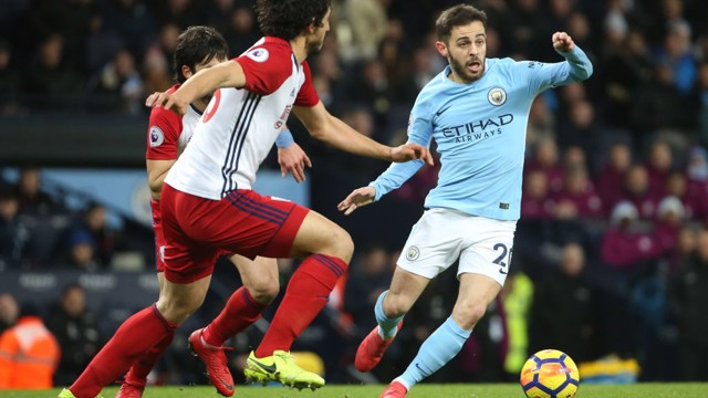 PROBING: Bernardo Silva cuts in off the flank.