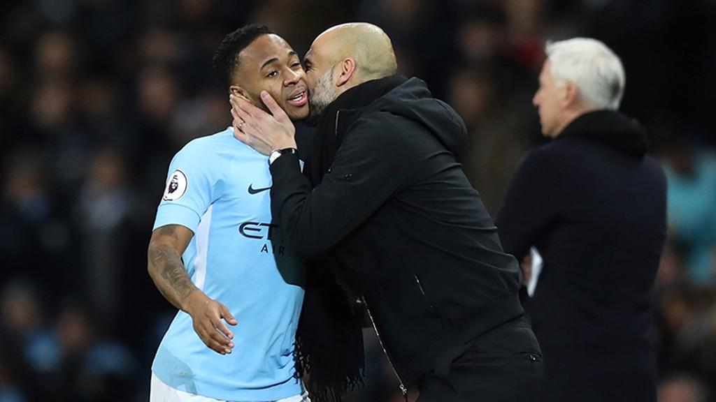 SMOOCH: Pep Guardiola kisses Raheem Sterling