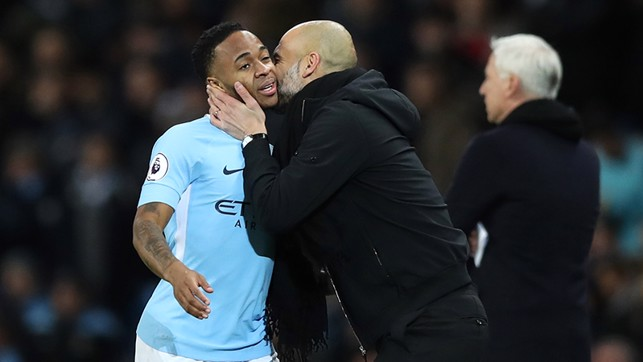 SMOOCH: Pep Guardiola kisses Raheem Sterling