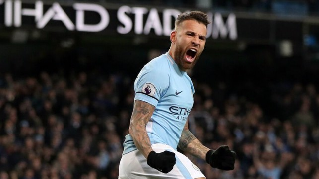 COMETH THE HOUR: Nicolas Otamendi rallies the crowd, after his leveller