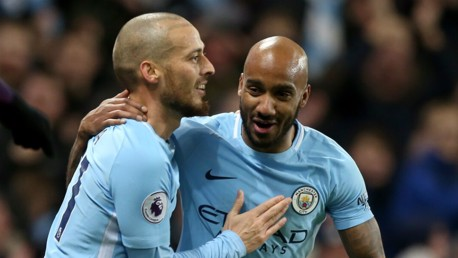 DELIGHT: Fabian Delph congratulates David Silva on his strike