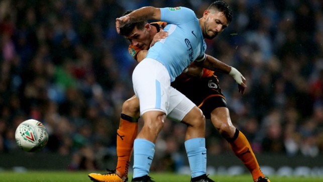 CLOSE QUARTERS: Sergio Aguero battles for possession