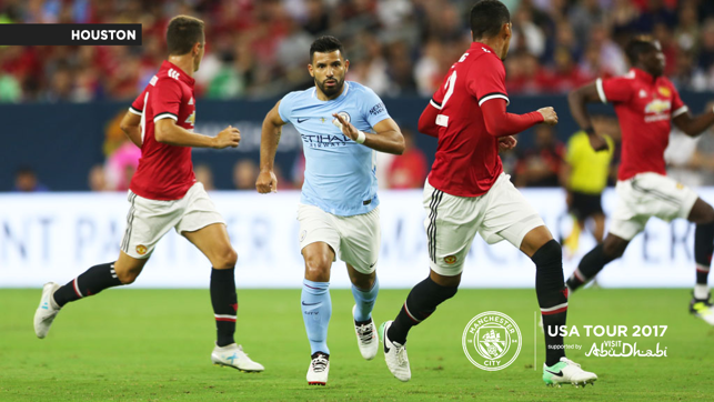 A CITY UNITED: Sergio Aguero takes on United