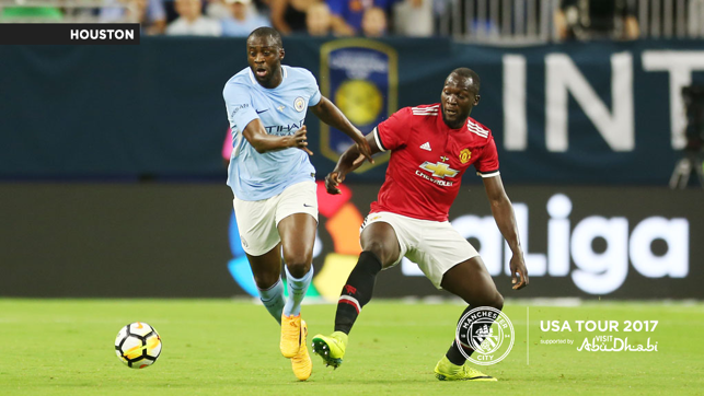 A CITY UNITED: Yaya Toure takes on Romelu Lukaku