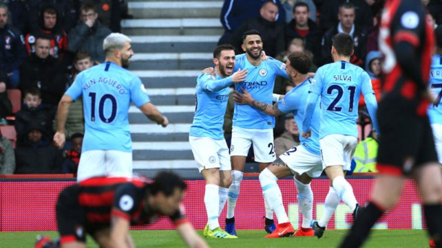 BLUE HEAVEN: Riyad Mahrez celebrates with his City team-mates after his crucial goal