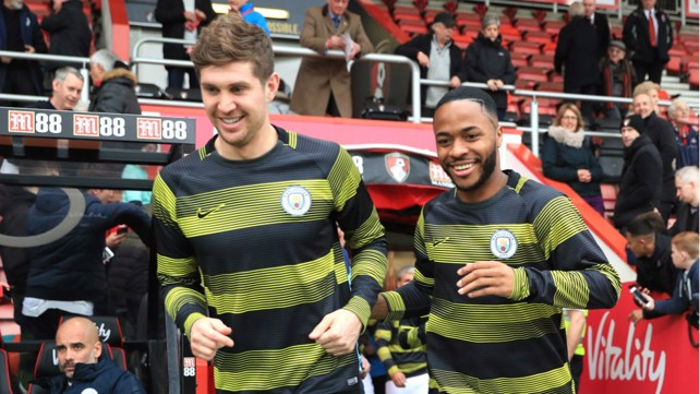 ALL SMILES: A fit-again John Stones and Raheem Sterling step out for City's pre-match warm-up