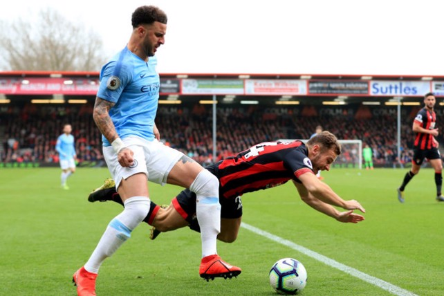 FALL GUY: Kyle Walker shows his strength to fend off Ryan Fraser who goes tumbling