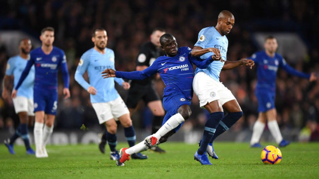 MY BALL: Fernandinho shows his strength to hold off Kante