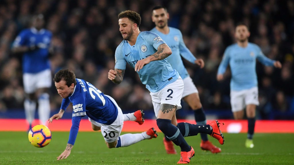 WALKER IN THE PARK: Kyle Walker fights for possession on the flank