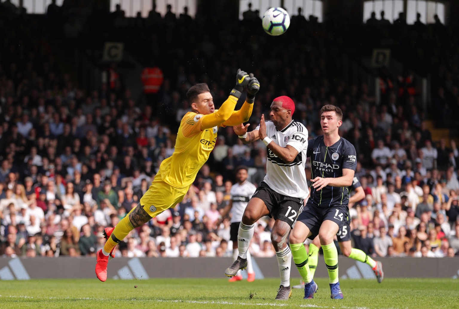 UP AND AWAY: Ederson punches clear