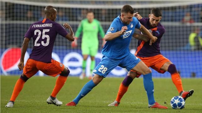 NO ENTRY: Fernandinho and Nicolas Otamendi put the squeeze on the hosts