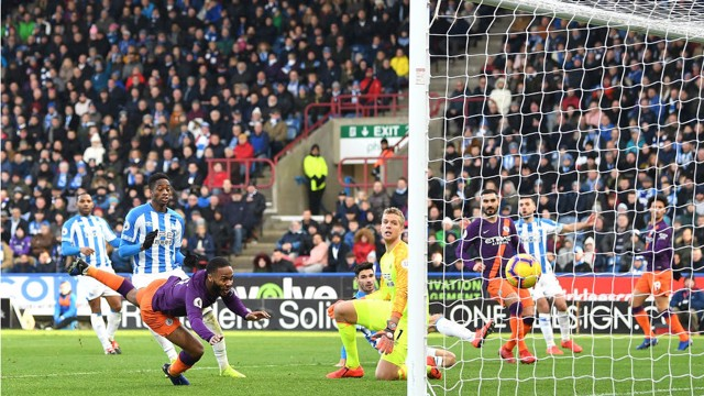 HEADS UP: Raheem Sterling swoops to head home City's second goal