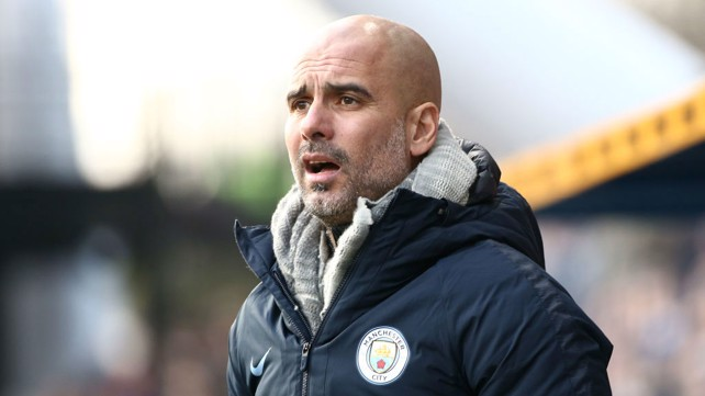 LEADING MAN: Pep looks on from sidelines as the action unfolds at the John Smith's Stadium