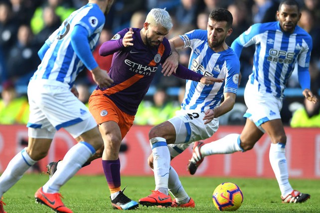 PERSISTENCE: Sergio muscles his way through the Terriers' defence