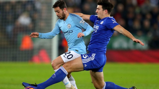 SHADOW PLAY: Bernardo Silva looks to shake off Harry Maguire