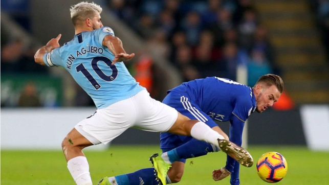 AT FULL STRETCH: Sergio Aguero challenges James Maddison
