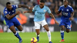 CENTRE OF ATTENTION: Raheem Sterling takes on Wes Morgan