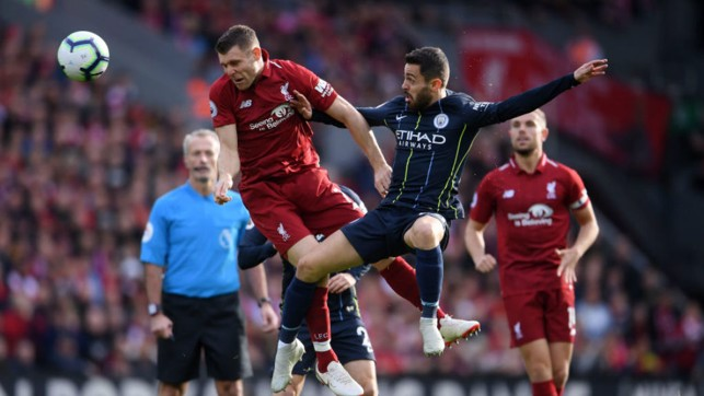 JUMP TO IT: Bernardo Silva challenges former City star James Milner