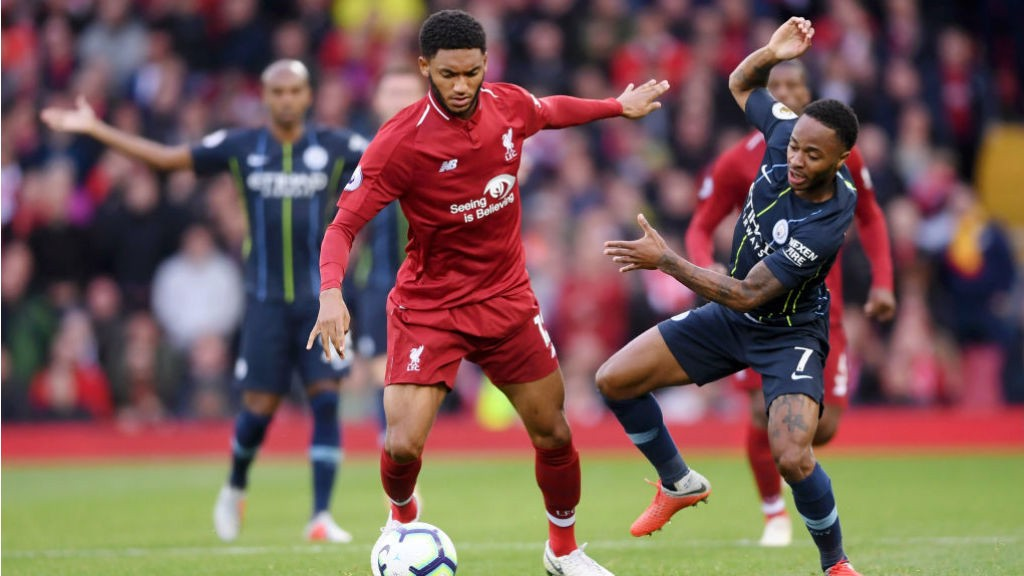 AT ARM'S LENGTH: Raheem Sterling looks to challenge Joe Gomez