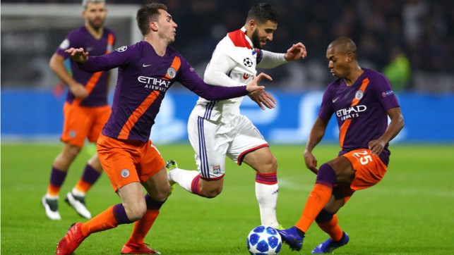 NO ENTRY: Fernandinho and Ayemric Laporte put the squeeze on Lyon dangerman Nabil Fekir