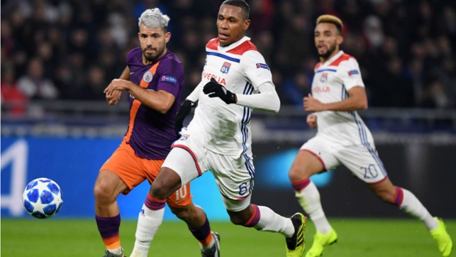 ACTION STATIONS: Sergio Aguero chases down Lyon's Marcelo