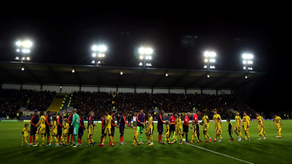 A NIGHT UNDER THE FLOODLIGHTS: The pre-match pleasantries...
