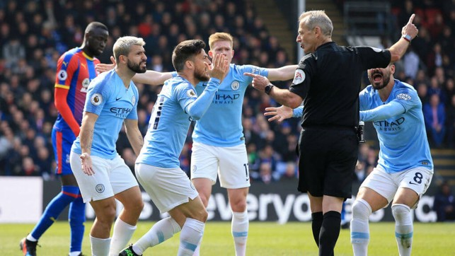 APPEAL: City players appeal for a free-kick on the edge of the box but are dismissed by referee Martin Atkinson.