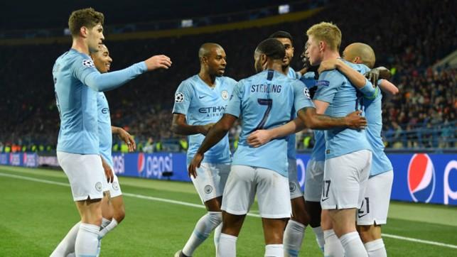 CELEBRATION TIME: The City players salute David Silva after the skipper's brilliant strike