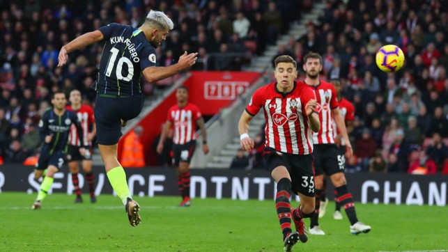 UP AND AT 'EM: Sergio Aguero leaps to head home our third goal in first half injury time