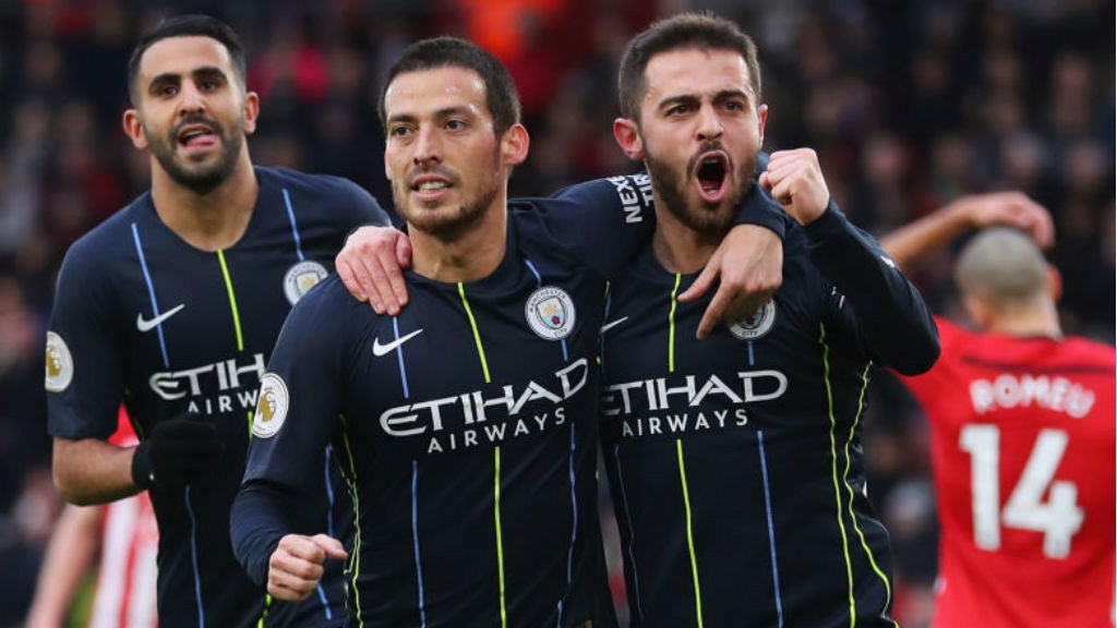 STARS ON SUNDAY: David Silva celebrates his early goal with Bernardo