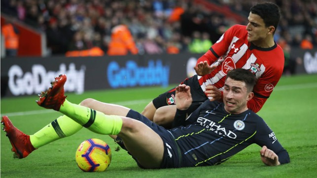 SLIDE RULE: Aymeric Laporte makes a timely challenge