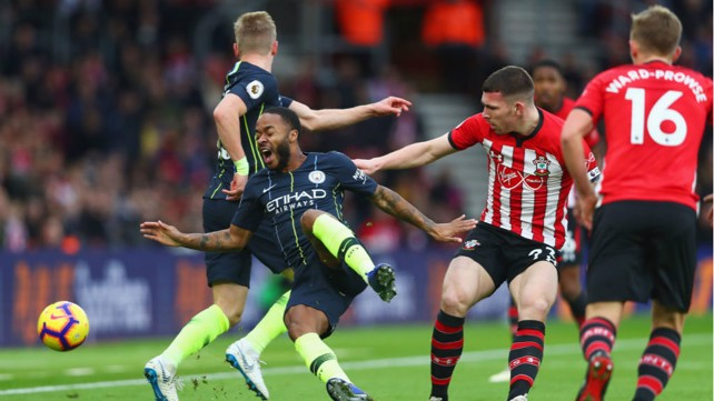 OUCH: Raheem Sterling is sent crashing by Pierre-Emile Hojbjerg