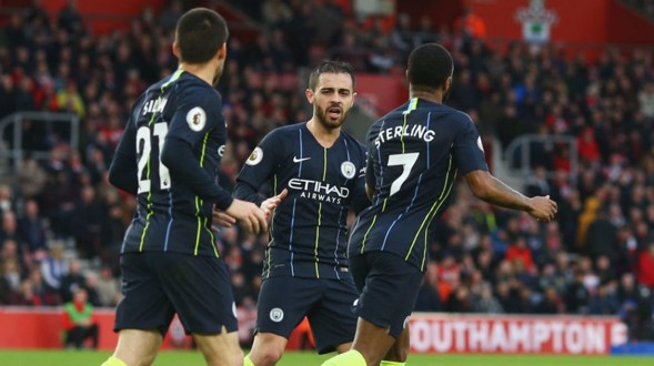 HELPING HAND: Bernardo celebrates with Raheem Sterling after Ward-Prowse's own goal