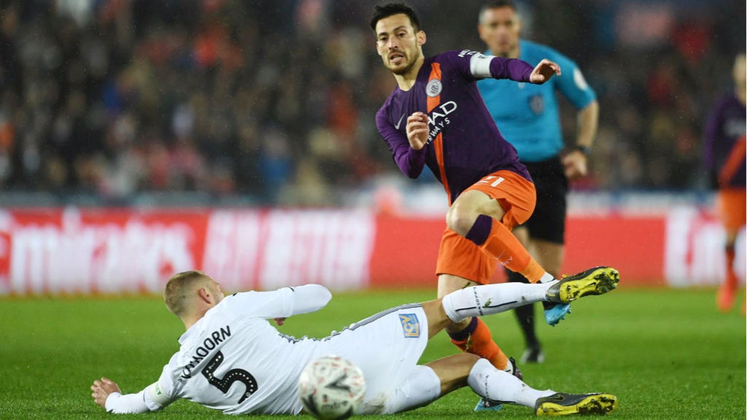 SKIP TO IT: David Silva evades the challenge of Swansea's Mike van der Hoorn