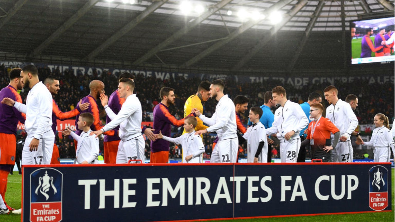 SHAKE ON IT: The players exchange greetings before kick-off