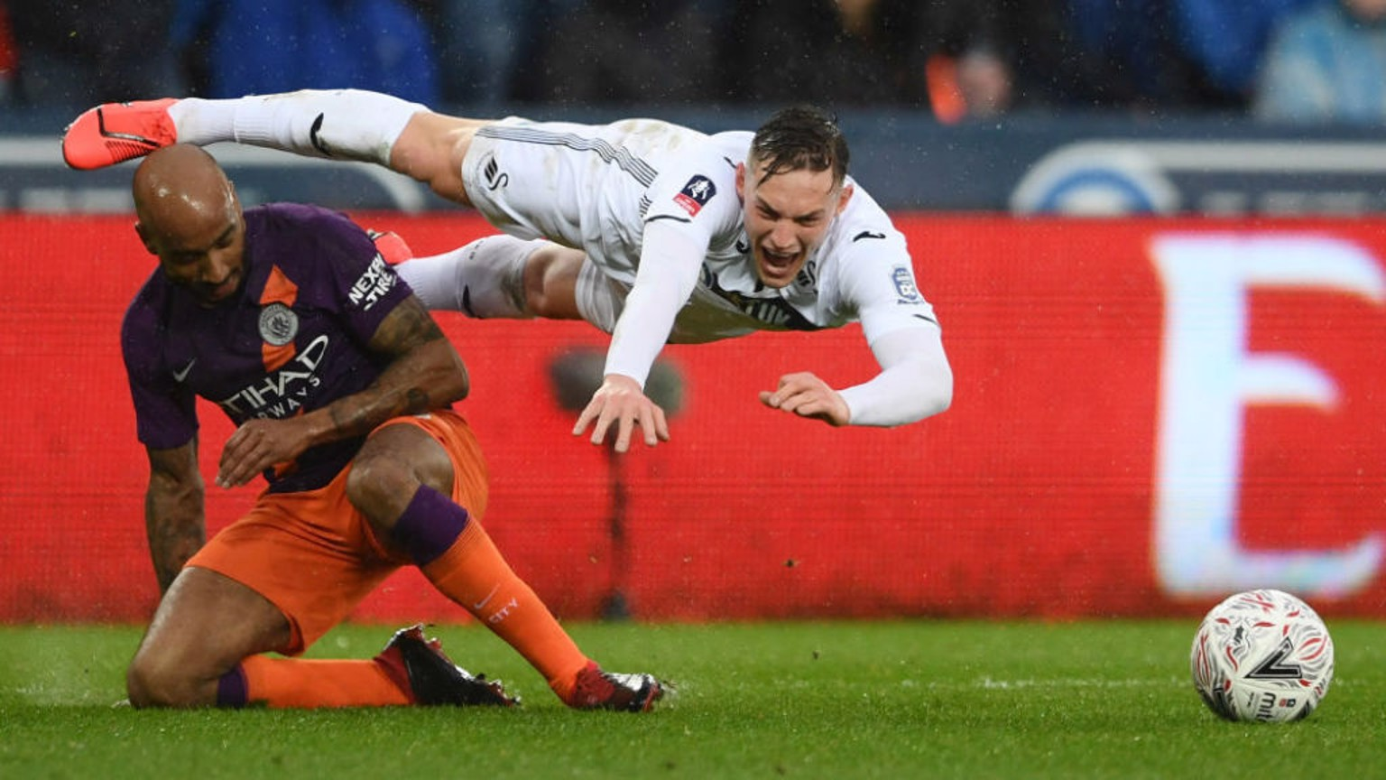 FLASHPOINT: Connor Roberts goes down after Fabian Delph's challenge to earn the hosts a first half penalty