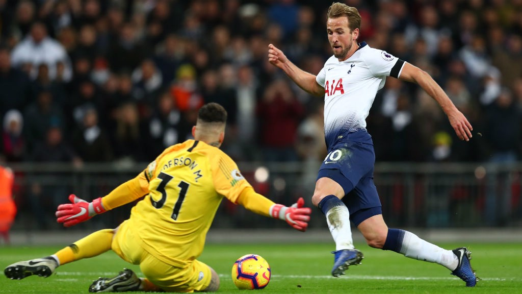 BLOCKED: _Ederson stops Harry Kane in his tracks as he charges towards goal