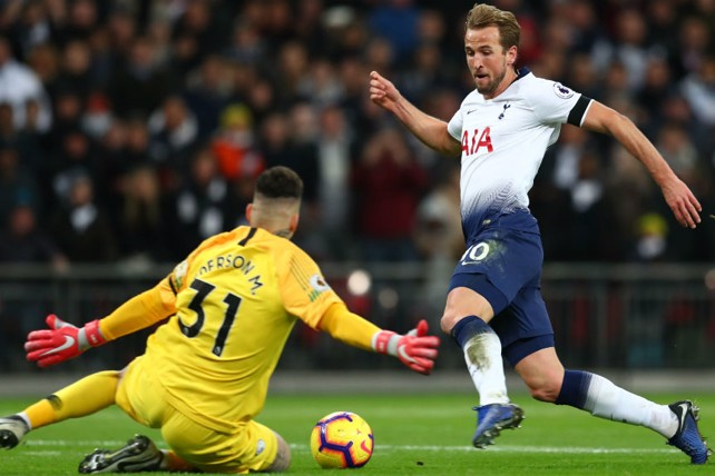 BLOCK: Ederson stops Harry Kane in his tracks as he charges towards goal.