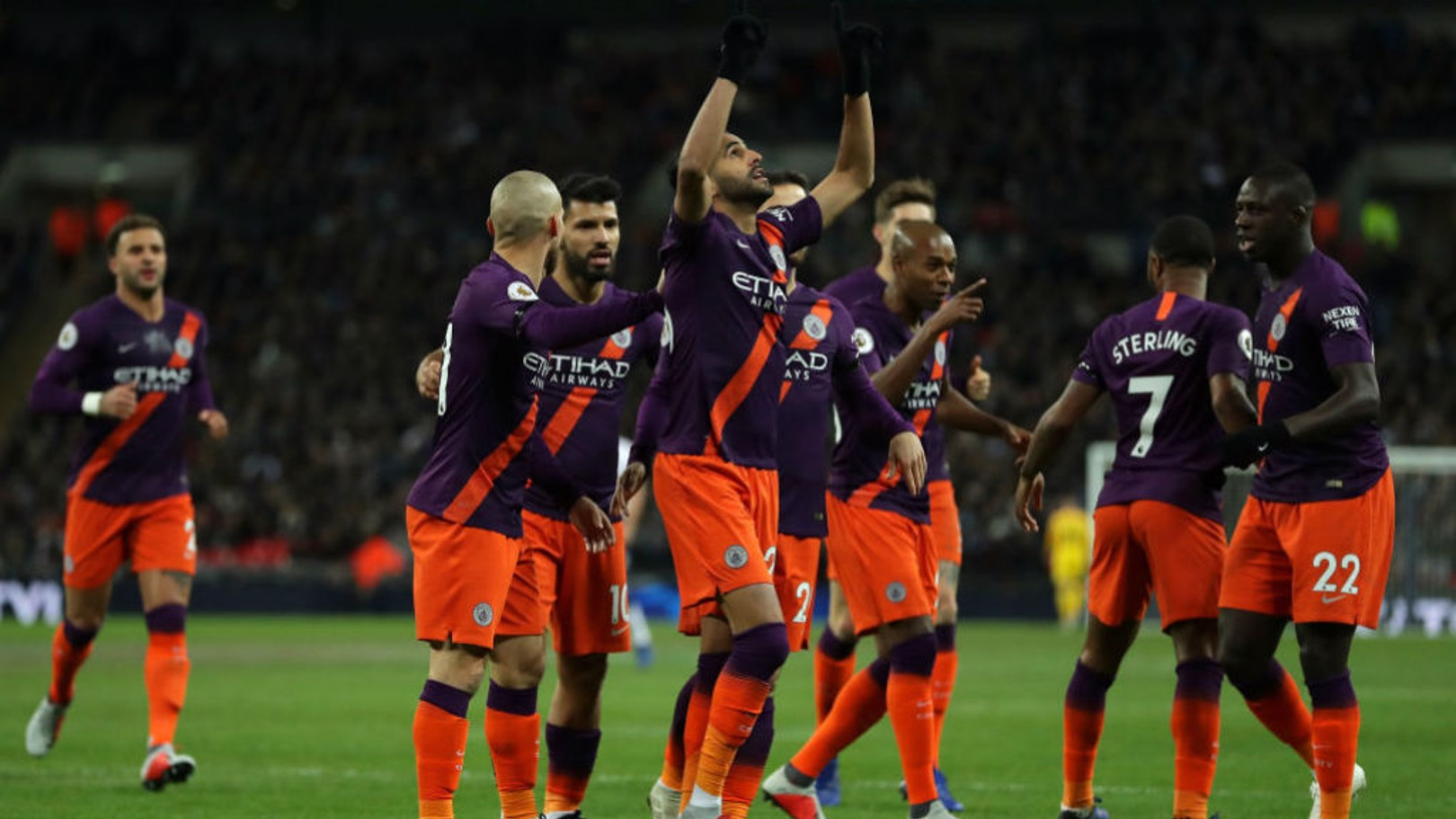 SQUAD: City celebrate after Mahrez bags his fifth goal for the club.