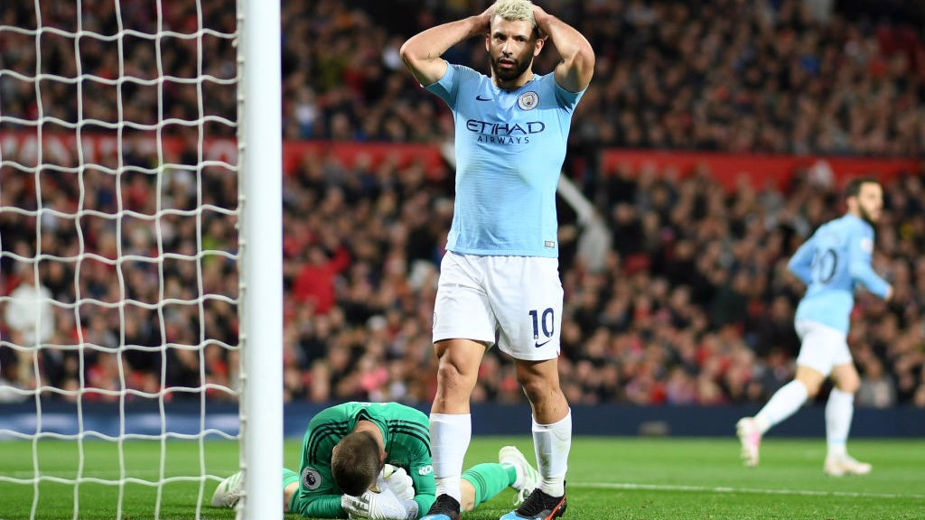 CLOSE CALL: Sergio Aguero can't hide his frustration after Raheem Sterling's goal-bound shot is saved by David De Gea