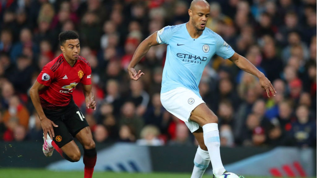 LEADING MAN: Skipper Vincent Kompany gets an early touch on the ball
