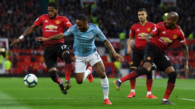 MAN IN THE MIDDLE: Raheem Sterling takes the fight to United