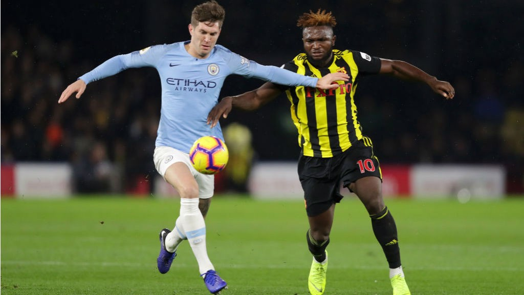 NO ENTRY: John Stones looks to close down Watford's Isaac Success