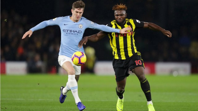 NO ENTRY: John Stones looks to close down Watford's Isaac Success