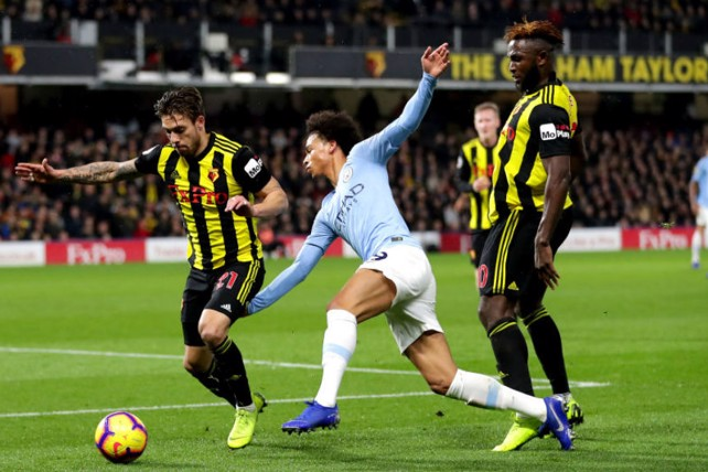 MAN DOWN: Leroy Sane slips as he looks to run at the Watford defence