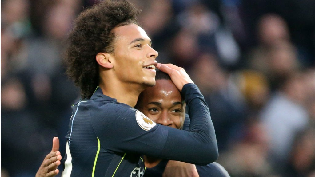 CITY SLICKERS: Leroy Sane and Raheem Sterling celebrate after City's second goal