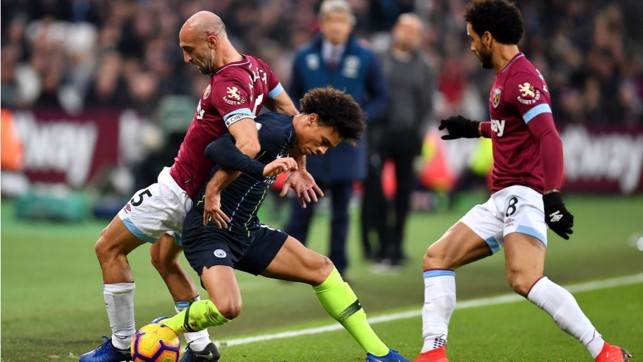 FAMILIAR FOE: Leroy Sane tangles with former City favourite Pablo Zabaleta