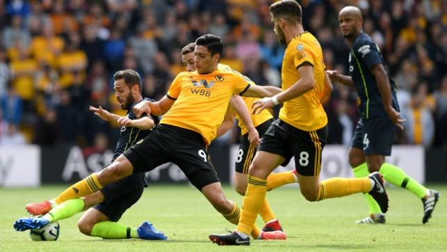 SLIDE RULE: Bernardo Silva is denied by some desperate Wolves defending