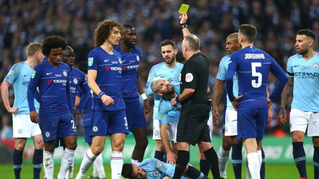 YELLOW FEVER: Antonio Rudiger is booked after bringing down David Silva